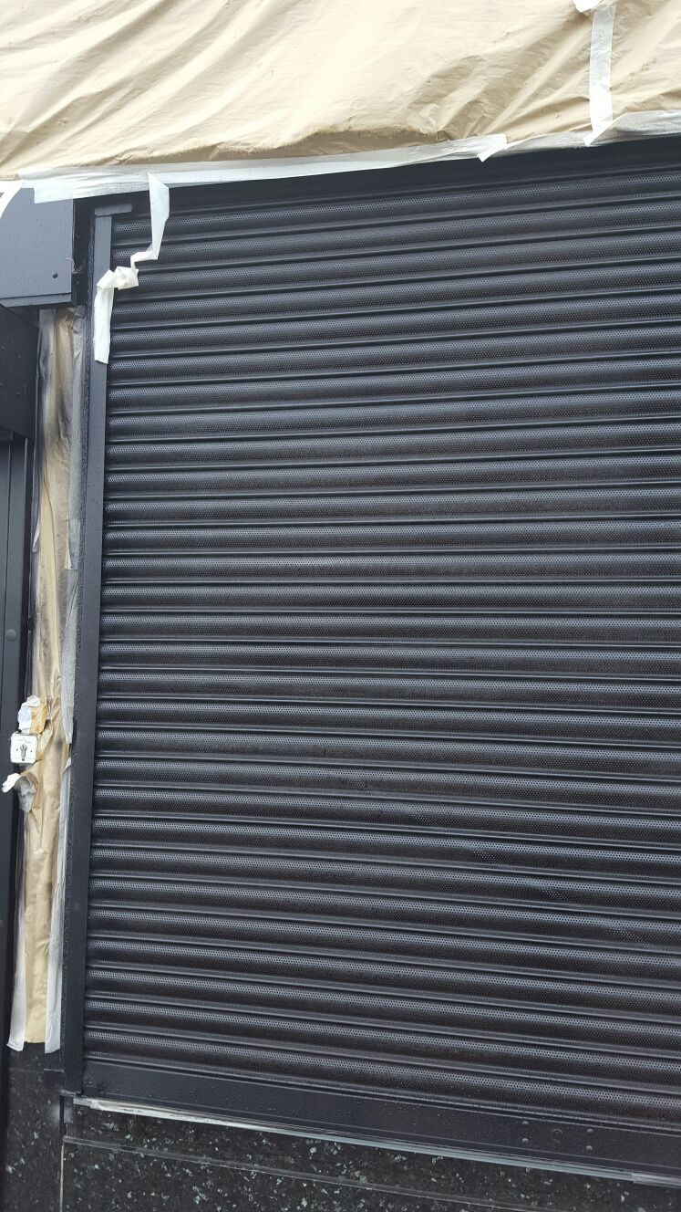 Roller Shutter Painting King Specialist Coatings Wall Coatings